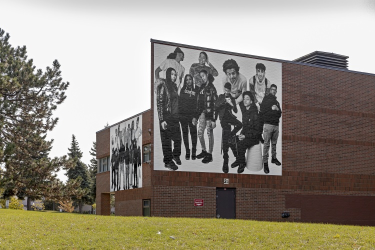 Ebti Nabag, Bubble of Youth, 2020, inkjet on vinyl; installation view from multi-site exhibition Three-Thirty, 2020, Lester B. Pearson Collegiate Institute (north façade), Scarborough, curated by Anique Jordan PHOTO: TONI HAFKENSCHEID; COURTESY OF SCOTIABANK CONTACT PHOTOGRAPHY FESTIVAL